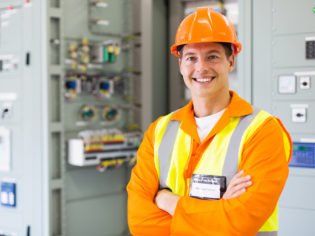 electrical engineer standing in control room